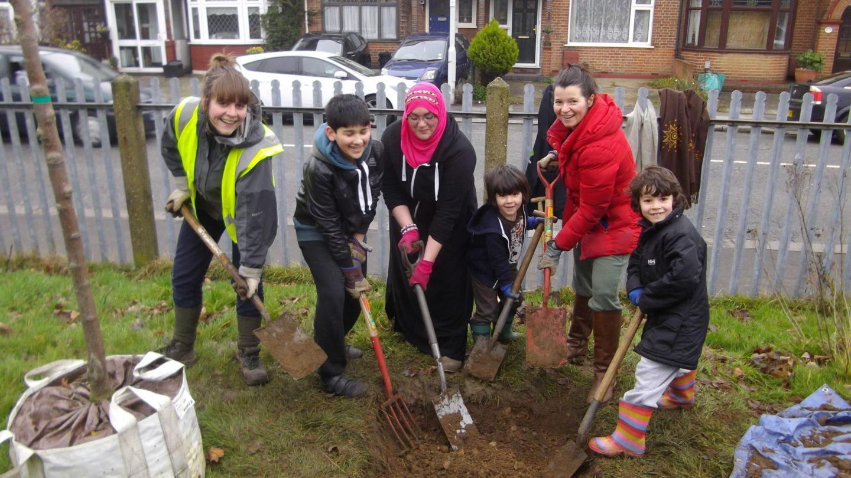Children planting trees in London